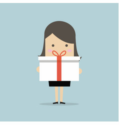 businesswoman holding a big gift box vector image