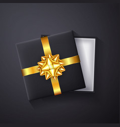 black gift box with golden bow and ribbon top vector image
