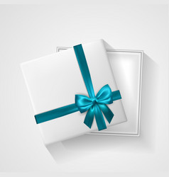 white open gift box with bow and ribbon top view vector image