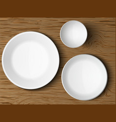 Set white dishes on a wooden vector
