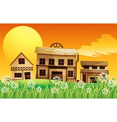 Wooden houses near the hill vector image