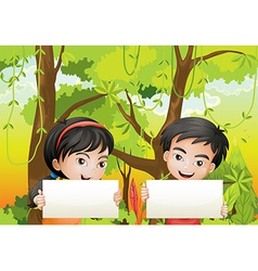 A girl and a boy with empty signages vector image vector image