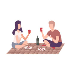 Couple having picnic in park man and woman vector