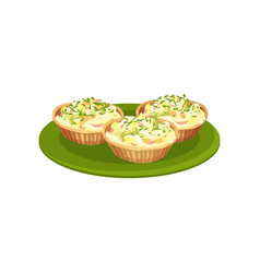 stuffed tartlets on green plate tasty food for vector image