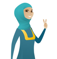 young muslim businesswoman showing victory gesture vector image