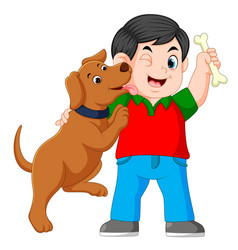 a boy holding bone with his dog vector image
