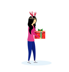 Asian woman wearing deer horns holding gift box vector