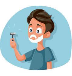 Funny teenage boy shaving holding razor vector