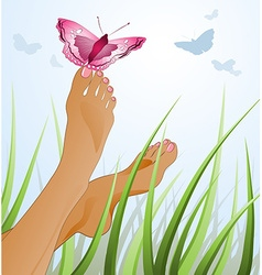 a Womans Feet Lying on a Grass with a Butterfly vector image
