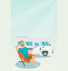 Man sitting in a chair in front of camper van vector