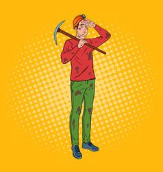 Pop art male miner in helmet with pickaxe vector