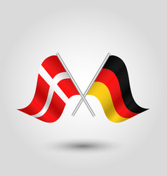 Two crossed danish and german flags vector
