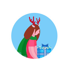Woman deer horns hold gift box happy new year vector