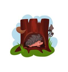 cute hedgehog sleeping in hollow of tree hollowed vector image