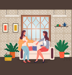 Two young girls sitting at sofa in living room vector