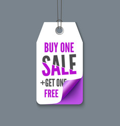 Violet tag with inscription buy one - get fre vector
