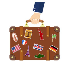 vintage old travel suitcase in hand vector image