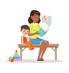 teacher reading a book to little boy while sitting vector image