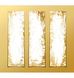 Set of gold grunge vertical banners vector