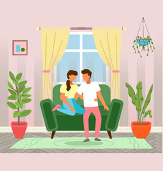 young married couple at home on couch sitting vector image