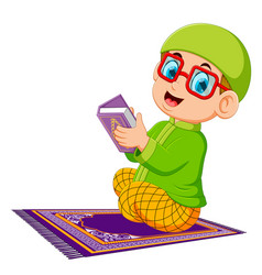 Boy using red glasses is holding al quran vector