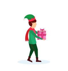 christmas boy carry gift box elf santa helper vector image