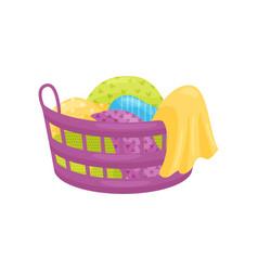 Purple plastic basket full of clean or dirty vector