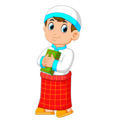 Boy with red sarong is holding al quran vector