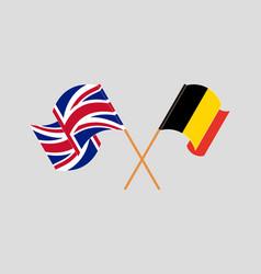Crossed and waving flags belgium and uk vector