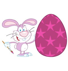 Rabbit Painting Easter Egg With Stars vector image vector image