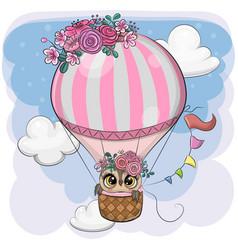 Cartoon owl is flying on a hot air balloon vector