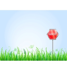 Red Stop Sign On Grass Meadow vector image