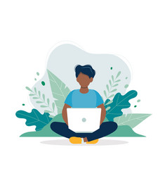 black man with laptop sitting in nature and leaves vector image