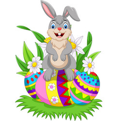 cartoon happy bunny with colorful easter eggs vector image