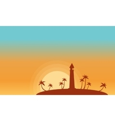 Silhouette of lighthouse and palm at sunset vector