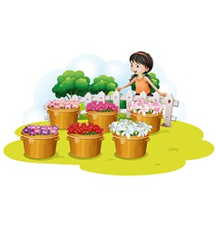 A girl looking at the flowers in the basket vector image