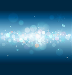 Blue background with bokeh and snowflakes vector