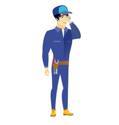 Mechanic talking on a mobile phone vector