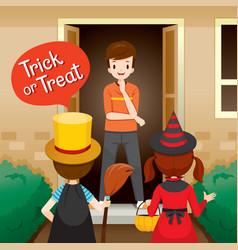 trick or treat children and man open door vector image vector image
