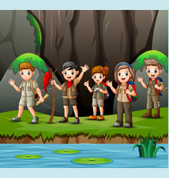Group young scout girls and boys in nature vector