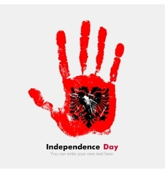Handprint with the flag of Albania in grunge style vector image