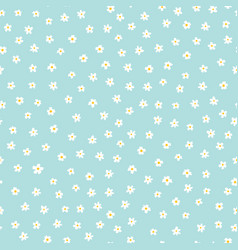 white ditsy flowers on blue seamless vector image