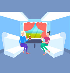 two women sitting together in train compartment vector image