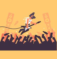 rock guitarist plays at concert vector image vector image