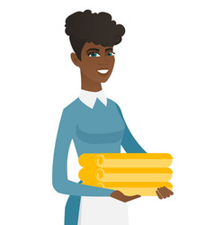 african housekeeping maid with stack of linen vector image