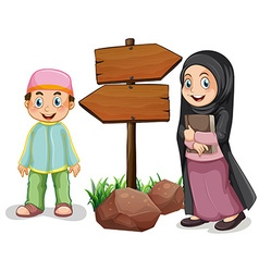 Two muslim kids and wooden signs vector image vector image