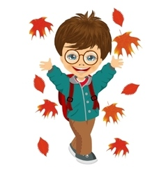 little boy playing with autumn leaves vector image
