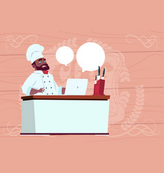 african american chef cook working at laptop vector image vector image