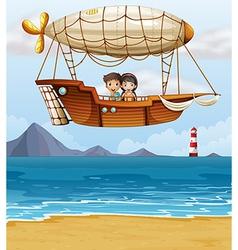 A boy and a girl riding an airship vector