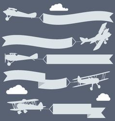 silhouettes biplanes with wavy greetings banner vector image